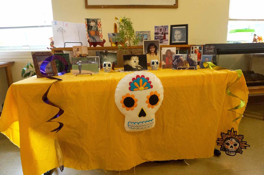 The Lower Elementary classroom altar was decorated with sugar skulls and pictures of loved ones and pets.