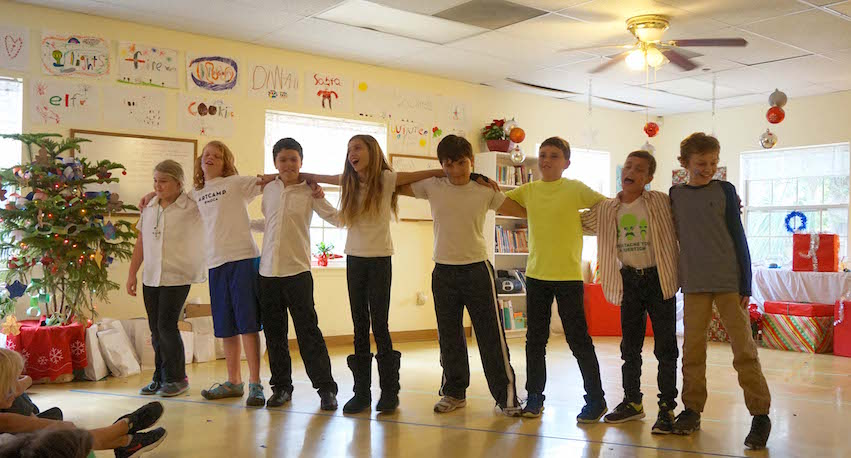 The Upper Elementary students celebrate with song and dance during the holiday party in December.