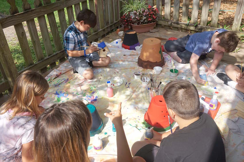The third-year students work on the birdbaths and birdhouses they chose for their legacy project.