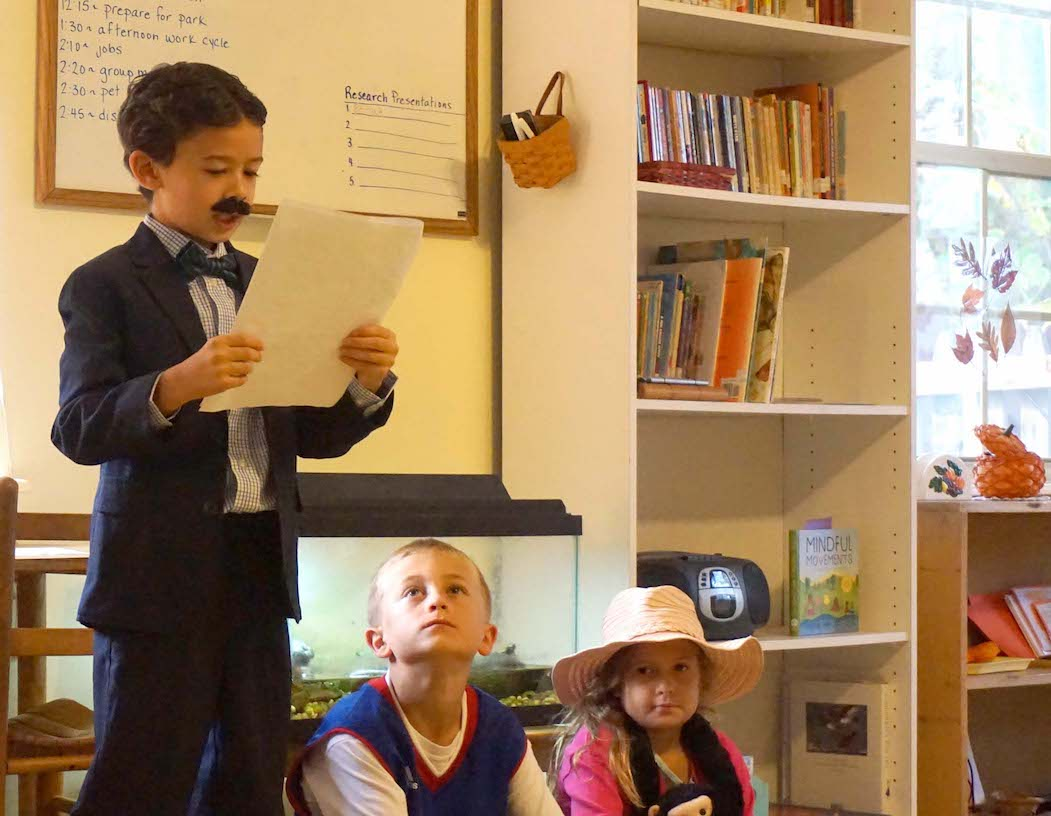 Nikola Tesla tells the Lower Elementary students about his life during the Historical Halloween presentations Monday.