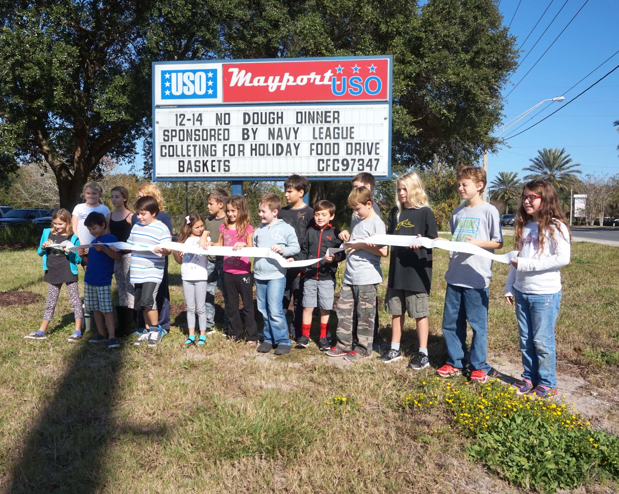 After shopping for and delivering $1,290 worth of food, the Elementary students posed with the receipt outside the USO Mayport Center on Friday.