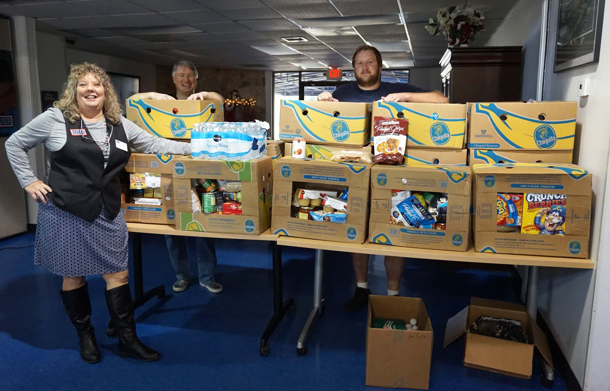 Joyce Schellhorn, from left, James and Mark of the USO Mayport Center welcomed the Elementary students and the 19 boxes of food they delivered.